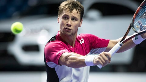 Ricardas Berankis of Lithuania returns the ball to Damir Dzumhur of Bosnia and Herzegovina during the final match at the Kremlin Cup tennis tournament in Moscow, Russia, Sunday, Oct. 22, 2017. (AP Photo/Pavel Golovkin)