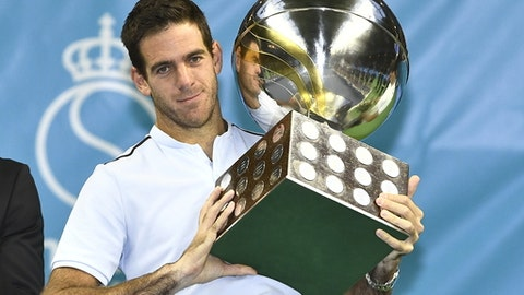 Juan Martin Del Potro of Argentina celebrates with the trophy after his win after defeating Bulgaria's Grigor Dimitrov in the men's singles final at the ATP Stockholm Open tennis tournament Sunday Oct. 22, 2017. (Claudio Bresciani/TT via AP)