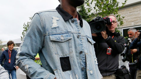 Usain Bolt walks through the garage area before the Formula One U.S. Grand Prix auto race at the Circuit of the Americas, Sunday, Oct. 22, 2017, in Austin, Texas. (AP Photo/Tony Gutierrez, Pool)