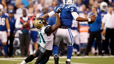 Jacksonville Jaguars defensive end Yannick Ngakoue (91) ties to tackle Indianapolis Colts quarterback Jacoby Brissett (7) during the first half of an NFL football game in Indianapolis, Sunday, Oct. 22, 2017. (AP Photo/Jeff Roberson)