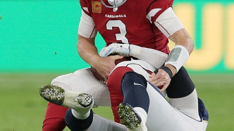 Arizona Cardinals quarterback Carson Palmer (3) is sacked during the first half of an NFL football game against Los Angeles Rams at Twickenham Stadium in London, Sunday Oct. 22, 2017. (AP Photo/Tim Ireland)