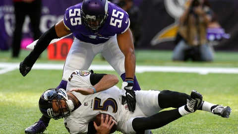 Baltimore Ravens quarterback Joe Flacco (5) is sacked by Minnesota Vikings outside linebacker Anthony Barr (55) during the second half of an NFL football game, Sunday, Oct. 22, 2017, in Minneapolis. (AP Photo/Jim Mone)