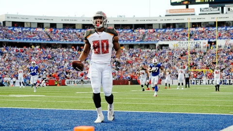Tampa Bay Buccaneers tight end O.J. Howard (80) celebrates after catching a pass for a touchdown during the second half of an NFL football game against the Buffalo Bills, Sunday, Oct. 22, 2017, in Orchard Park, N.Y. (AP Photo/Adrian Kraus)