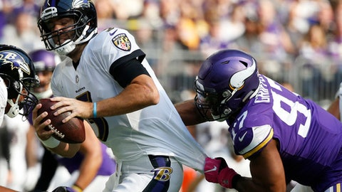 Minnesota Vikings defensive end Everson Griffen, right, sacks Baltimore Ravens quarterback Joe Flacco during the second half of an NFL football game, Sunday, Oct. 22, 2017, in Minneapolis. (AP Photo/Bruce Kluckhohn)
