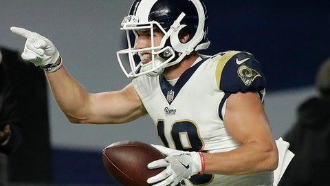 Los Angeles Rams wide receiver Cooper Kupp celebrates after scoring a touchdown during the second half of an NFL football game against Arizona Cardinals at Twickenham Stadium in London, Sunday Oct. 22, 2017. (AP Photo/Matt Dunham)