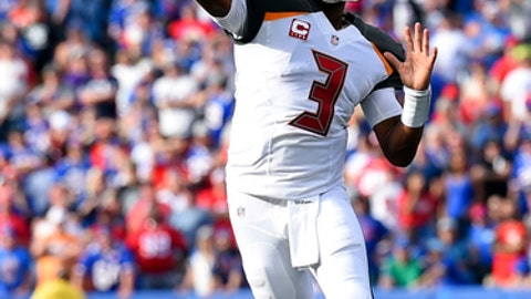 Tampa Bay Buccaneers quarterback Jameis Winston (3) throws a pass for a touchdown to Mike Evans during the second half of an NFL football game against the Buffalo Bills, Sunday, Oct. 22, 2017, in Orchard Park, N.Y. (AP Photo/Rich Barnes)
