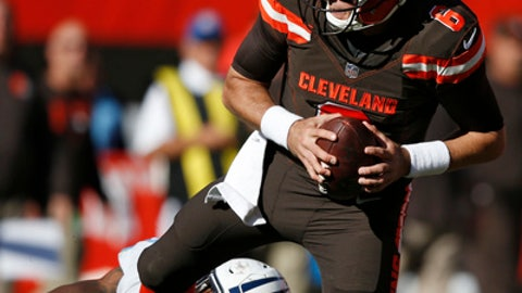 Cleveland Browns quarterback Cody Kessler (6) is sacked by Tennessee Titans outside linebacker Derrick Morgan (91) in the second half of an NFL football game, Sunday, Oct. 22, 2017, in Cleveland. (AP Photo/Ron Schwane)