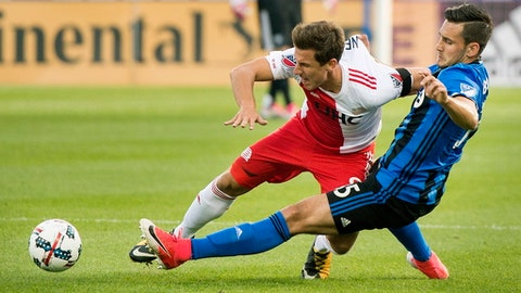 Montreal Impact's Deian Boldor (35) challenges New England Revolution's Krisztian Nemeth during first-half MLS soccer game action in Montreal, Sunday, Oct. 22, 2017. (Graham Hughes/The Canadian Press via AP)