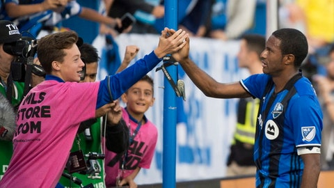 Montreal Impact's Patrice Bernier, right, celebrates after scoring during first-half MLS soccer game action against the New England Revolution in Montreal, Sunday, Oct. 22, 2017. (Graham Hughes/The Canadian Press via AP)