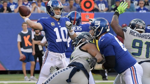New York Giants quarterback Eli Manning throws during the first half of an NFL football game against the Seattle Seahawks, Sunday, Oct. 22, 2017, in East Rutherford, N.J. (AP Photo/Bill Kostroun)