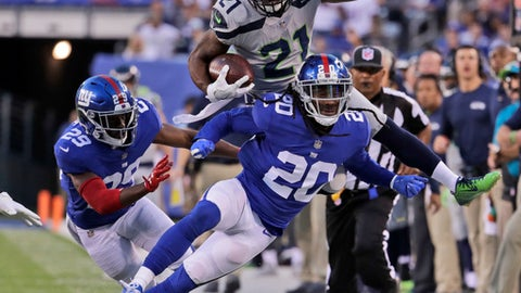 Seattle Seahawks J.D. McKissic jumps over New York Giants' Janoris Jenkins (20) during the first half of an NFL football game, Sunday, Oct. 22, 2017, in East Rutherford, N.J. (AP Photo/Julio Cortez)