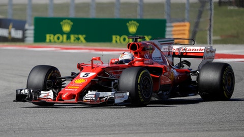 Ferrari driver Sebastian Vettel, of Germany, comes through a turn during the Formula One U.S. Grand Prix auto race at the Circuit of the Americas, Sunday, Oct. 22, 2017, in Austin, Texas. (AP Photo/Darron Cummings)