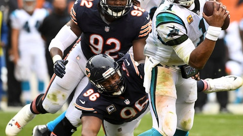 Chicago Bears defensive end Akiem Hicks (96) and outside linebacker Pernell McPhee (92) close in on Carolina Panthers quarterback Cam Newton (1) during an NFL football game in Chicago, Ill. , Sunday, Oct. 22, 2017. (Rick West/Daily Herald via AP)
