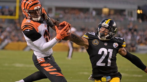 Cincinnati Bengals wide receiver Cody Core (16) can't stay in bounds as he comes down with a pass with Pittsburgh Steelers cornerback Joe Haden (21) defending during the second half of an NFL football game in Pittsburgh, Sunday, Oct. 22, 2017. (AP Photo/Fred Vuich)