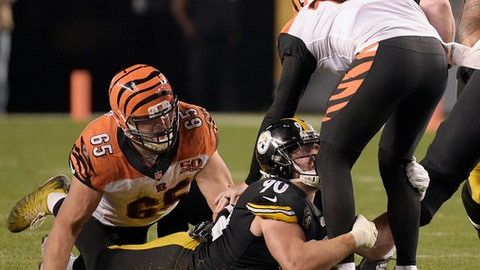 Pittsburgh Steelers outside linebacker T.J. Watt (90) sacks Cincinnati Bengals quarterback Andy Dalton (14) with Bengals offensive guard Clint Boling (65) defending during the second half of an NFL football game in Pittsburgh, Sunday, Oct. 22, 2017. (AP Photo/Fred Vuich)