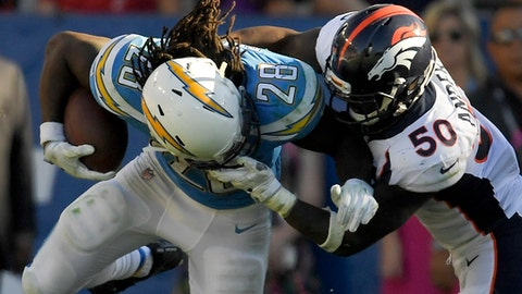 Denver Broncos inside linebacker Zaire Anderson, right, grabs Los Angeles Chargers running back Melvin Gordon by the face mask during the second half of an NFL football game Sunday, Oct. 22, 2017, in Carson, Calif. (AP Photo/Mark J. Terrill)