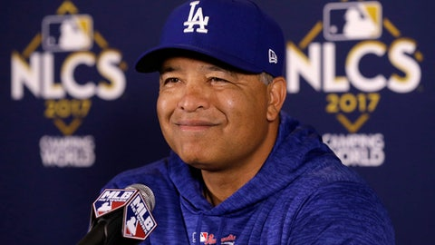 FILE - In this Oct. 17, 2017, file photo, Los Angeles Dodgers manager Dave Roberts talks during a news conference before Game 3 of baseball's National League Championship Series against the Chicago Cubs in Chicago. Roberts was a surprise choice to be the Dodgers' next manager two years ago. After leading the 104-win Dodgers to their first World Series in 29 years this fall, the former outfielder has a chance to add another major achievement in baseball history to his monumental stolen base during the Boston Red Sox's 2004 championship run. (AP Photo/Charles Rex Arbogast, File)