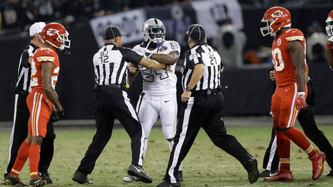 FILE - In this Oct. 19, 2017, file photo, Oakland Raiders running back Marshawn Lynch (24) makes contact with back judge Greg Steed (12) during the first half of an NFL football game between the Raiders and the Kansas City Chiefs in Oakland, Calif., Thursday, Oct. 19, 2017. Lynch was ejected after the play. (AP Photo/Ben Margot, File)