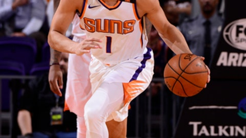 PHOENIX, AZ - OCTOBER 23:  Devin Booker #1 of the Phoenix Suns handles the ball against the Sacramento Kings on October 23, 2017 at Talking Stick Resort Arena in Phoenix, Arizona. NOTE TO USER: User expressly acknowledges and agrees that, by downloading and or using this photograph, user is consenting to the terms and conditions of the Getty Images License Agreement. Mandatory Copyright Notice: Copyright 2017 NBAE (Photo by Barry Gossage/NBAE via Getty Images)