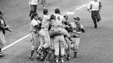 FILE - In this Oct. 10, 1957, file photo, Milwaukee Braves' Frank Torre (14) jumps on the back of pitcher Lew Burdette as the Braves celebrate their 5-0 victory over the New York Yankees in Game 7 of the World Series in New York. (AP Photo, File)