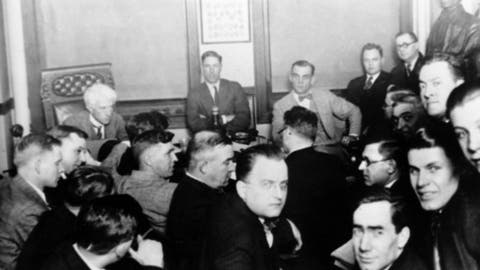 "FILE - In this 1921 file photo, Judge Kenesaw Mountain Landis, rear left, talks with Chicago White Sox players during the investigation of the infamous ""Black Sox"" scandal in Chicago, Ill. At rear center is Charles ""Swede"" Risberg, and next to Risberg is Arnold ""Chick"" Gandil. Others are unidenified. Hal Bock, an Associated Press sports writer from 1963-2004, served as chief baseball writer and columnist, and he covered 30 World Series. He is the author of ""Banned: Baseball's Blacklist of All-Stars and Also-Rans,"" published by Diversion Books. (AP Photo/File)"