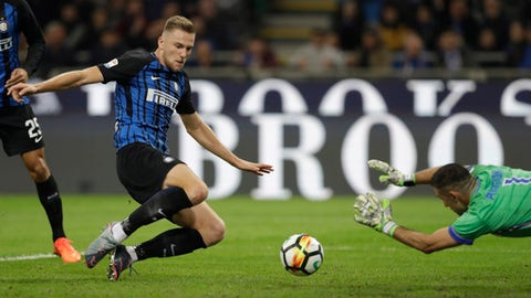 Inter Milan's Milan Skriniar scores first goal for his side during an Italian Serie A soccer match between Inter Milan and Sampdoria, at the San Siro stadium in Milan, Italy, Tuesday, Oct. 24, 2017. (AP Photo/Luca Bruno)