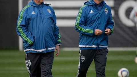 FILE - In this Oct. 27, 2015 file photo, Seattle Sounders head coach Sigi Schmid, left, watches player drills with assistant coach Brian Schmetzer, right, during an MLS soccer training session in Tukwila, Wash. (AP Photo/Ted S. Warren, file)