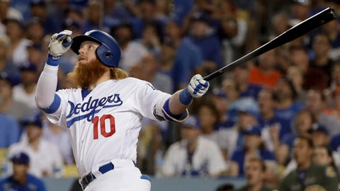 Los Angeles Dodgers' Justin Turner watches his two-run home run against the Houston Astros during the sixth inning of Game 1 of baseball's World Series Tuesday, Oct. 24, 2017, in Los Angeles. (AP Photo/Matt Slocum)