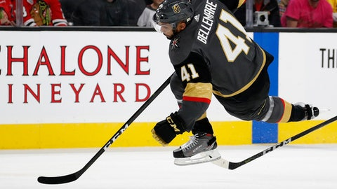 Vegas Golden Knights left wing Pierre-Edouard Bellemare falls to the ice during the second period of an NHL hockey game against the Chicago Blackhawks, Tuesday, Oct. 24, 2017, in Las Vegas. (AP Photo/John Locher)