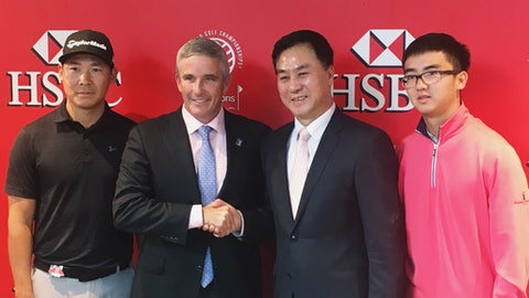 PGA Tour commissioner Jay Monahan, center left, shakes hands with Zhang Xiaoning, president of the China Golf Association, after announcing a deal at the WGC-HSBC Champions golf tournament in Shanghai on Wednesday, Oct. 25, 2017, to resume the PGA Tour China Series. They are flanked by Zhang Xinjun, far left, and Dou Zecheng, who used the China series as a springboard to become the first Chinese players to earn full PGA Tour cards. (AP Photo/Doug Ferguson)