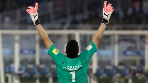 Brazil's Gabriel Brazao celebrates after his team scored a goal against England's during their FIFA U-17 World Cup semifinal match in Kolkata, India, Wednesday, Oct. 25, 2017. (AP Photo/Bikas Das)