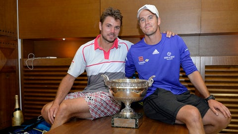 Switzerland's Stan Wawrinka, left, poses with his coach Magnus Norman, of Sweden, and the cup in the cloakroom of the stadium after winning the French Open tennis tournament against Serbia's Novak Djokovic, at the Roland Garros stadium, Sunday, June 7, 2015 in Paris.  (Christophe Saidi, FFT, Pool via AP)