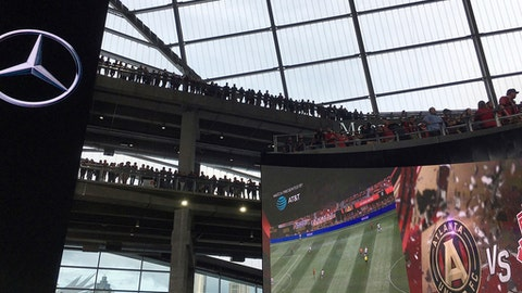 In this Oct. 22, 2017 photo, a record crowd of 71,874 packs Mercedes-Benz Stadium for Atlanta United's regular-season finale against Toronto FC, in Atlanta. United also set a Major League Soccer season record by averaging 48,200 per game in their inaugural year. in Atlanta. (AP Photo/Paul Newberry)