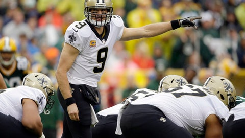 FILE - In this Sunday, Oct. 22, 2017, file photo, New Orleans Saints quarterback Drew Brees (9) calls a play at the line of scrimmage during the first half of an NFL football game against the Green Bay Packers in Green Bay, Wis. Long known as a passing team, the Saints have turned their season around with better defense and a commitment to the running game, reducing the burden on their veteran QB. (AP Photo/Jeffrey Phelps, File)
