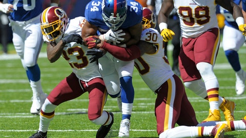 "FILE - In this Sept. 25, 2016 file photo, Washington Redskins DeAngelo Hall (23) and David Bruton (30) tackle New York Giants running back Shane Vereen (34) during the first half of an NFL football game in East Rutherford, N.J. Players at ages once considered to be their prime playing years now struggle to find jobs as the NFL has undergone a dramatic youth movement in the past decade as teams grow more inclined to go with cheaper more inexperienced players ahead of seasoned veterans. ""I thought the reason we supposedly changed the CBA was to keep veteran guys around, quote-unquote, but that hasn't been what's materialized,"" said Washington cornerback DeAngelo Hall, who entered the league in 2004. ""It's been: Go younger. Go cheaper."" (AP Photo/Bill Kostroun, File)"