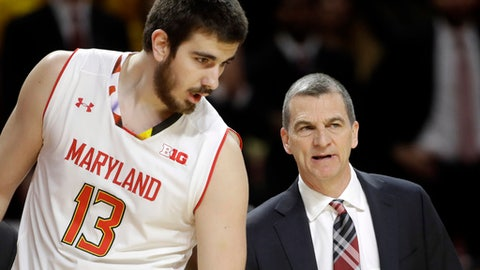 In this March 4, 2017, photo, Maryland forward Ivan Bender, left, of Bosnia and Herzegovina, speaks with head coach Mark Turgeon in the first half of an NCAA college basketball game against Michigan State in College Park, Md. The resurgence of the Maryland basketball program can be attributed in no small part to Melo Trimble, whose scoring and leadership helped the Terrapins make three straight trips to the NCAA Tournament. This season, Maryland intends to sustain that success without him. (AP Photo/Patrick Semansky)