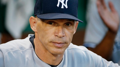 FILE - In this July 16, 2017, file photo, New York Yankees manager Joe Girardi stands in the dug out before the second game of a baseball doubleheader against the Boston Red Sox, in Boston. The New York Yankees announced Thursday, Oct. 26, 2017, that Girardi will not return to the team in the 2018 season. The announcement was made by Yankees Senior Vice President and General Manager Brian Cashman.  (AP Photo/Michael Dwyer, File)