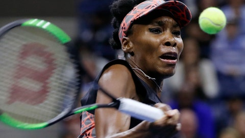 FILE - In this Sept. 7, 2017, file photo, Venus Williams returns a shot from Sloane Stephens during the semifinals of the U.S. Open tennis tournament,in New York. Venus Williams reached the semifinals at the WTA Finals by beating Wimbledon champion Garbine Muguruza 7-5, 6-4 on Thursday, Oct. 26, 2017. (AP Photo/Adam Hunger, File)