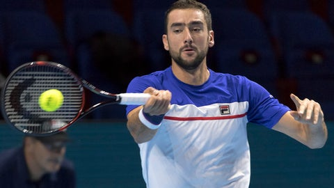 Croatia's Marin Cilic returns a ball to Croatia's Borna Coric during their round of sixteen match at the Swiss Indoors tennis tournament at the St. Jakobshalle in Basel, Switzerland, on Thursday, Oct. 26, 2017. (Georgios Kefalas/Keystone via AP)