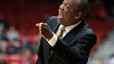 FILE - In this Feb. 1, 2017, file photo, Washington State head coach Ernie Kent directs his team during the first half of an NCAA college basketball game against UCLA in Pullman, Wash. The Cougars are forecast for the third straight year to finish last in the Pacific-12.  That's not all that surprising, considering they lost five of the six leading scorers from a team that finished 13-18 and ninth in the league.   (AP Photo/Young Kwak, File)