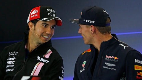 Force India driver Sergio Perez, of Mexico, left, talks with Red Bull driver Max Verstappen of the Netherlands, during a press conference at the Hermanos Rodriguez racetrack in Mexico City, Thursday, Oct. 26, 2017. (AP Photo/Moises Castillo)