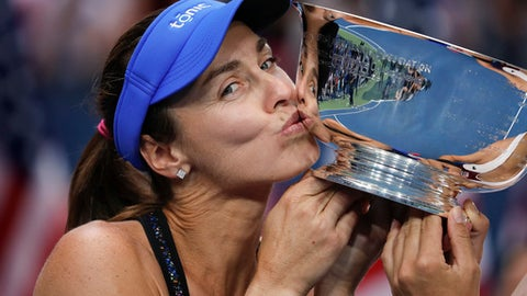 FILE - In this Sunday, Sept. 10, 2017 file photo, Martina Hingis, of Switzerland, kisses the women's doubles championship trophy next to partner Chan Yung-Jan, of Taiwan, not pictured, after beating Katerina Siniakova, of Czech Republic, and Lucie Hradecka, of the Czech Republic, in the women's doubles final of the U.S. Open tennis tournament. Martina Hingis announced Thursday, Oct. 26 that she will retire from tennis for the third time in her career at the end of the ongoing WTA Finals. The Swiss initially confirmed the news on Twitter and Facebook after winning her quarterfinal doubles match.(AP Photo/Julie Jacobson, File)