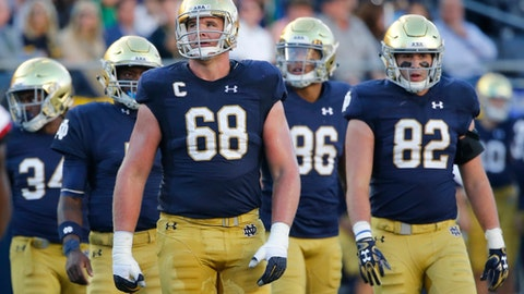 """FILE - In this Sept. 30, 2017, file photo, Notre Dame offensive lineman Mike McGlinchey (68) looks up at the scoreboard during the first half of an NCAA college football game against Miami (Ohio) in South Bend, Ind. """"Offensive line's the only position in sports where you have five guys going as one, and we take a lot of pride in that,"""" senior left tackle Mike McGlinchey said this week as No. 9-ranked Notre Dame (6-1) prepared for Saturday's visit by No. 14 North Carolina State (6-1).(AP Photo/Charles Rex Arbogast, File)"""