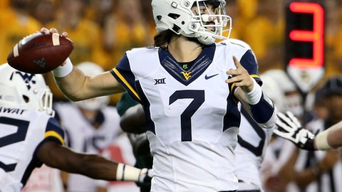 FILE - In this Saturday, Oct. 21, 2017, file photo, West Virginia quarterback Will Grier (7) throws a pass in the first half of an NCAA college football game in Waco, Texas. Grier has the most touchdown passes in the nation with 26 and will be going for more when No. 22 West Virginia hosts No. 11 Oklahoma State on Saturday. (AP Photo/Jerry Larson, File)