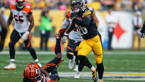 FILE - In this Oct. 22, 2017, file photo, Pittsburgh Steelers running back Le'Veon Bell (26) plays in an NFL football game against the Cincinnati Bengals, in Pittsburgh. Bell wanted the ball. The Pittsburgh Steelers are giving it to him at a near-record pace. (AP Photo/Keith Srakocic, File)