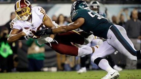 FILE - In this Monday, Oct. 23, 2017, file photo, Washington Redskins tight end Jordan Reed (86) dives in for a touchdown as Philadelphia Eagles linebacker Najee Goode (52) tries to stop him during the second half of an NFL football game in Philadelphia. Tight end, not too long ago almost an afterthought for many teams, has become a critical spoke in the offensive wheel. (AP Photo/Matt Rourke, File)