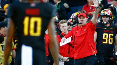 FILE - In this Oct. 14, 2017, file photo, Maryland head coach DJ Durkin, right, directs his players from the sideline during the first half of an NCAA college football game against Northwestern in College Park, Md. Durkin is in his second year as Maryland's head coach, and Tom Allen is laboring through his first full season at Indiana. Both have seen their teams bullied by the conference elite, yet each remains steadfast in their belief that better times lie ahead. (AP Photo/Patrick Semansky, File)