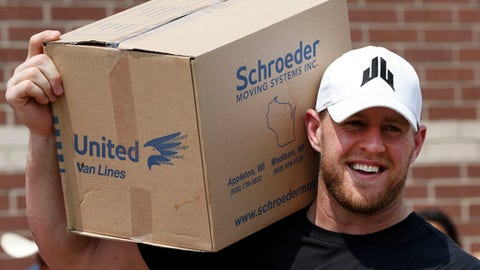 FILE - In this Sept. 3, 2017, file pool photo, Houston Texans defensive end J.J. Watt holds a box of relief supplies on his shoulder while handing them out to people impacted by Hurricane Harvey in Houston. Watt has announced plans for how the more than $37 million he raised in the wake of Hurricane Harvey will be distributed.  The Texans' defensive end will divide $30.15 million of the donations between Americares, Feeding America, SBP and Save the Children.   (Brett Coomer/Houston Chronicle via AP, Pool, File)
