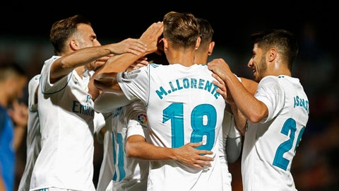 Real Madrid players celebrate their side's second goal against Fuenlabrada during a Spanish Copa del Rey round of 32 first leg soccer match between Fuenlabrada and Real Madrid at the Fernando Torres stadium in Fuenlabrada, outside Madrid, Thursday, Oct. 26, 2017. Real Madrid won 2-0. (AP Photo/Francisco Seco)