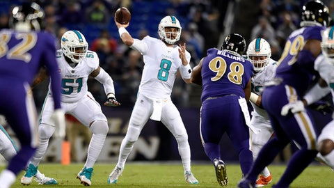 Miami Dolphins quarterback Matt Moore (8) throws to a receiver in the first half of an NFL football game against the Baltimore Ravens, Thursday, Oct. 26, 2017, in Baltimore. (AP Photo/Gail Burton)